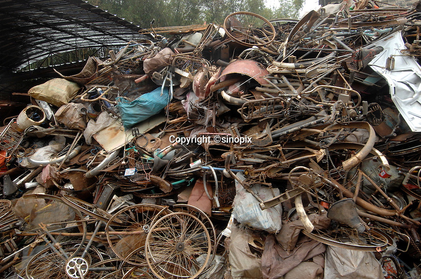 A bicycle dump at a village outside Guilin City, Guangxi Province, China. Bicyles are being eschewed by the Chinese public in many cities in favour of motor-cycles and cars which are seen as status symbols..02 Mar 2007