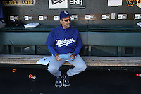 SAN FRANCISCO - AUGUST 1:  Manager Joe Torre #6 of the Los Angeles Dodgers gets ready in the dugout before the game against the San Francisco Giants at AT&T Park on August 1, 2010 in San Francisco, California. Photo by Brad Mangin