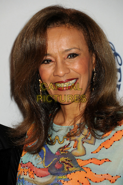 MARILYN McCOO.32nd Anniversay Carousel of Hope Gala held at the Beverly Hilton Hotel, Beverly Hills, California, USA, .23rd October 2010..Portrait headshot smiling green print orange dragon.CAP/ADM/BP.©Byron Purvis/AdMedia/Capital Pictures.