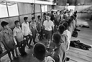 Bien Hoa, Vietnam. April 1970. Businessman Ross Perot, founder of Electronic Data Systems, Inc., visits a Prisoners of War camp where prisoners sleep on boards in Bien Hoa, South Vietnam. He was appointed by United States Secretary of the Navy John Warner to report on the conditions of Americans in Vietnamese and Laotian POW camps for four years, until the prisoners were released in 1972 at the end of the Vietnam War.