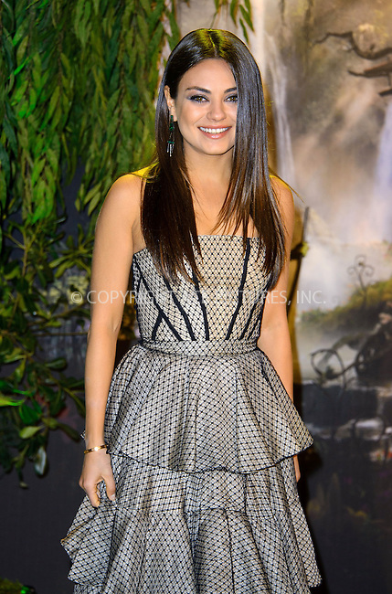 WWW.ACEPIXS.COM....US Sales Only....February 28 2013, London....Mila Kunis at the European premiere of 'Oz the Great and Powerful' held at the Empire Leicester Square cinema on February 28 2013 in London....By Line: Famous/ACE Pictures......ACE Pictures, Inc...tel: 646 769 0430..Email: info@acepixs.com..www.acepixs.com