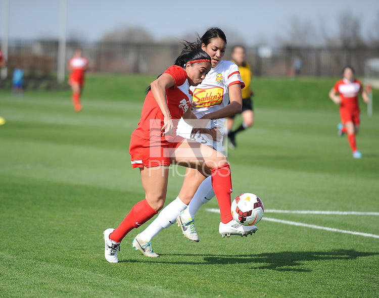 Boyds MD - April 13, 2014: Renae Cuellar (9) of the Washington Spirit  goes against Haley Palmer (23) of the Western New York Flash. The Western New York Flash defeated the Washington Spirit 3-1 in the opening game of the 2014 season of the National Women's Soccer League at the Maryland SoccerPlex.