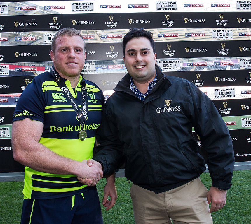 Man of the Match Leinster's Sean Cronin presented by Sam Harries of Guinness <br /> <br /> Photographer Simon King/CameraSport<br /> <br /> Guinness PRO12 Round 19 - Ospreys v Leinster Rugby - Saturday 8th April 2017 - Liberty Stadium - Swansea<br /> <br /> World Copyright &copy; 2017 CameraSport. All rights reserved. 43 Linden Ave. Countesthorpe. Leicester. England. LE8 5PG - Tel: +44 (0) 116 277 4147 - admin@camerasport.com - www.camerasport.com