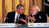 United States President Barack Obama talks to Prime Minister Narendra Modi of India at  a working dinner with heads of delegations at the Nuclear Security Summit at the White House on March 31, 2016.<br /> Credit: Dennis Brack / Pool via CNP