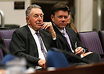 Former Nevada Assembly Republicans John Carpenter, left, and Chad Christensen listen to a hearing at the Legislative Building in Carson City, Nev., on Wednesday, April 22, 2015. <br /> Photo by Cathleen Allison