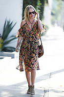 Summer look: Kate Bosworth clutched her iPad and wore a floating floral print summer dress with ankle high cowboy booties while leaving a salon in West Hollywood. Los Anageles, California on 1.6.2012..Credit: Vida/face to face /MediaPunch Inc. ***FOR USA ONLY***