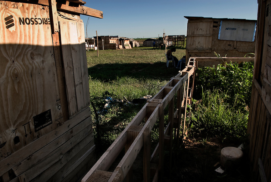 "Villa El Libertador, Cordoba, Argentina...""If the life we live is not dignified, our dignity is the struggle to change it.""..La Toma - the take of a piece of land, left uncultivated for years by the great soya entrepreneurs in Argentina. Around 250 families have decided to take the situation in their own hands, fighting to gain the right to have a house, while waiting for the state and the local authorities to face the serious living conditions and disoccupation problems in the shantytowns of Argentinas second biggest city Cordoba."