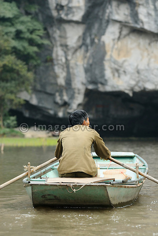 Asia, Vietnam, Tam Coc near Ninh Binh. In the watery landscape of Tam Coc (Three Caves) boats are a main transport.