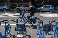 "Bicycle enthusiast Rahav Segev uses a Citibike in the Chelsea neighborhood of New York on Monday, May 27, 2013 on the first day of the city's bike-sharing program. 6000 bikes in over 300 stations have been placed so far for the roll out of the program. Cyclists purchased one-year passes for $95 which gives them unlimited 45 minute rides to get from point ""A"" to point ""B"". Daily and hourly passes will soon be available.  (© Richard B. Levine)"