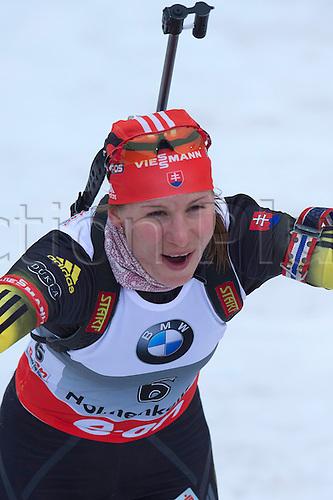 22.03.2014  Oslo, Norway The E.ON IBU World Cup Biathlon 2014  Anastasiya Kuzmina of Slovakia wins the ladies 10 kilometre  pursuit at The EON IBU World Cup Biathlon Final from Holmenkollen in Oslo, Norway.