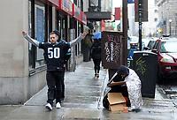 Philadelphia Eagles fan Chris Rosenberg of Jenkintown cheers for the team as he passes a homeless person on Locust Street Sunday, February 04, 2018 in Philadelphia, Pennsylvania. WILLIAM THOMAS CAIN / For The Inquirer