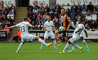 David Meyler of Hull City (3rdL) is challenged by three Swansea players Gylfi Sigurdsson, Leroy Fer and Wayne Routledge during the Premier League match between Swansea City and Hull City at the Liberty Stadium, Swansea on Saturday August 20th 2016