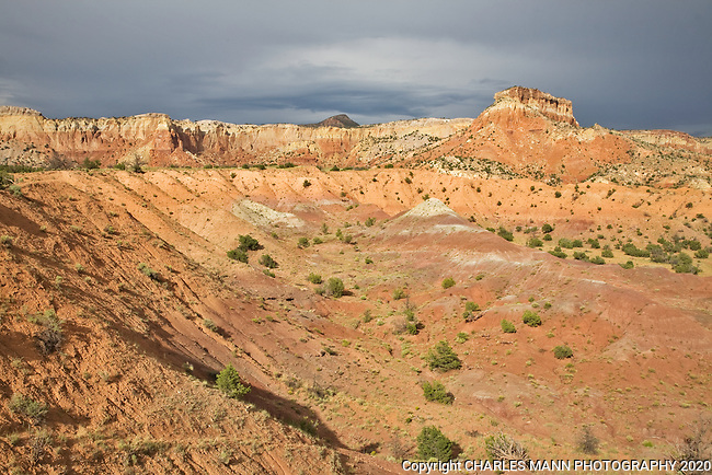 The red sandstone cliffs of Kitchen Mesa at Ghost Ranch near Abiquiu, New Mexico, create a dramatic landscape.