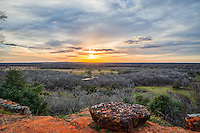 This is a fablous scenic overlook of the<br /> Texas landscape as the sun set in the sky.   We loved the big granite boulder and the view of the ranch below with the river running through it as the sunset with these wonderful clouds were really beginning to pop the sky.  Just another wonderful  scenic sunset over the Texas landscape