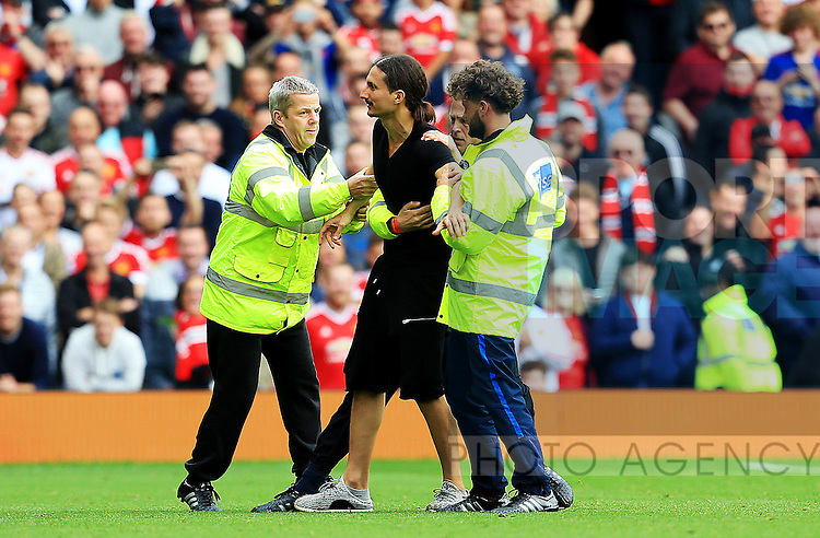 A Zlatan Ibrahimovic look a like is removed from the pitch during the Premier League match at Old Trafford Stadium, Manchester. Picture date: September 24th, 2016. Pic Sportimage