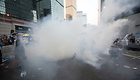 Hong Kong police fire tear gas at pro-democracy protesters during the first day of the mass civil disobedience campaign Occupy Central, Hong Kong, China, 28 September 2014.