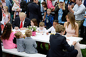 First Lady Melania Trump (R) and United States President Donald Trump  make cards for members of the military at the annual Easter Egg roll on the South Lawn of the White House in Washington, DC, on April 17, 2017. <br /> Credit: Olivier Douliery / Pool via CNP