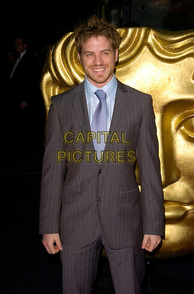 ROBERT KAZINSKY.The 12th British Academy of Film and TV Childrens Awards at the Hilton, Park Lane, London, England..November 25th 2007 .BAFTA BAFTA's half length grey gray pinstripe suit stubble facial hair .CAP/CAN.©Can Nguyen/Capital Pictures