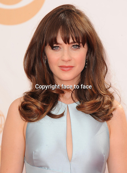 Zooey Deschanel arrives at the 65th Primetime Emmy Awards at Nokia Theatre on Sunday Sept. 22, 2013, in Los Angeles.<br />
