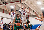 WOODBURY, CT. 08 January 2020-010820BS559 - Wilby's Jonathan Matias (23), center, before going up with the ball for a shot, uses a ball fake to get Nonnewaug players Colby Steinfeld (1), left, and Ethan Ciesieiski (30) up in the air, during a Boys Basketball game betweem Wilby and Nonnewaug at Nonnewaug High School in Woodbury on Wednesday. Bill Shettle Republican-American