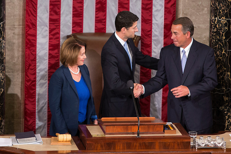 UNITED STATES - OCTOBER 29 - Incoming speaker Rep. Paul Ryan, R-Wis., shakes hands with outgoing Speaker John Boehner, R-Ohio, as House Minority Leader Nancy Pelosi, D-Calif., stands beside in the House Chambers of the U.S. Capitol in Washington, Thursday, October 29, 2015. (Photo By Al Drago/CQ Roll Call)