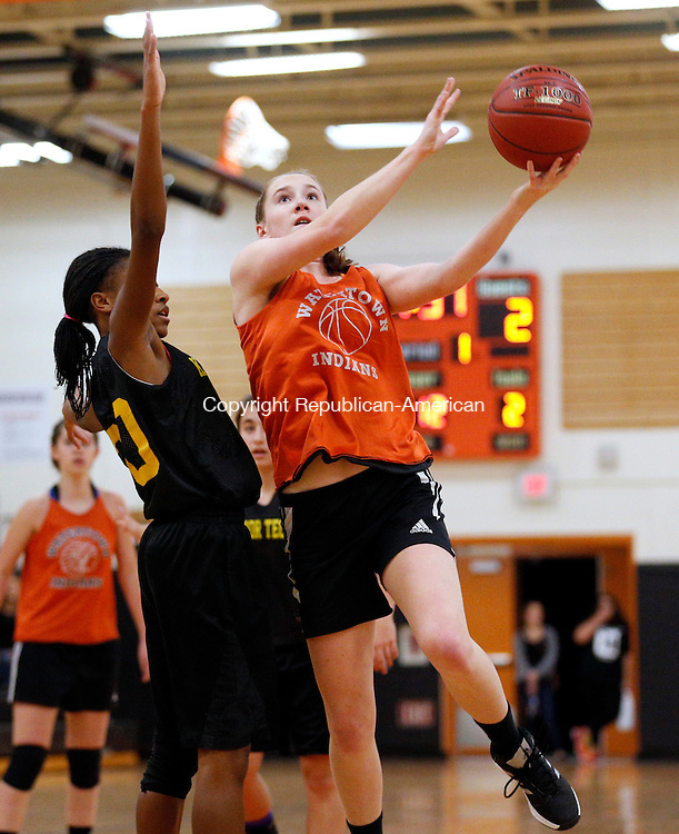 Watertown, CT- 04 December 2015-1204115CM12- Watertown's Mary Zaborowski, drives to the hoop against Kaynor Tech's Egypt Santos during a scrimmage in Watertown on Friday.     Christopher Massa Republican-American