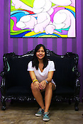29 year old Filipino gallerist, Gaby B. dela Merced poses for a photo at the Vinyl on Vinyl gallery at The Collective in Makati, Manila in Philippines. Behind Gaby is a painting of famous Indonesian artist, Arkik Vilmansa. Photo: Sanjit Das
