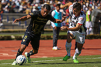 Mexico City September 23, 2014. Pumas player Javier Cortes (11) defends the ball to the threat of Monterrey player Efrain Velarde (22) during the final day of the regular season of league MX. Encounter in which Pumas won 4-2 at Monterrey to classify quarterfinals. Photo by Miguel Angel Pantaleon/VIEWpress