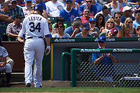 Chicago Cubs pitcher Jon Lester (34) walks back to the dugout after striking out as Joe Maddon looks on during a game against the Milwaukee Brewers on August 13, 2015 at Wrigley Field in Chicago, Illinois.  Chicago defeated Milwaukee 9-2.  (Mike Janes/Four Seam Images)