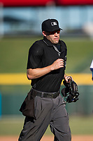 Home plate umpire Dan Merzel during an Arizona Fall League game between the Peoria Javelinas and the Mesa Solar Sox at Sloan Park on November 6, 2018 in Mesa, Arizona. Mesa defeated Peoria 7-5 . (Zachary Lucy/Four Seam Images)