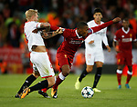 Daniel Sturridge of Liverpool in action with Simon Kjaer of Sevilla during the Champions League Group E match at the Anfield Stadium, Liverpool. Picture date 13th September 2017. Picture credit should read: Simon Bellis/Sportimage