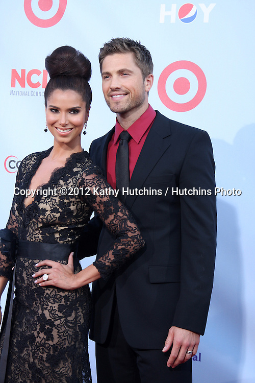 LOS ANGELES - SEP 16:  Roselyn Sanchez, Eric Winter arrives at the 2012 ALMA Awards at Pasadena Civic Auditorium on September 16, 2012 in Pasadena, CA