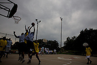 teams play each other at a basketball tournament organized by a local pastor in Roseland, Chicago, Illinois, United States on Wednesday August 6 2008..The pastor promotes sports as a way to defeat violence..Senator Barack Obama, the 2008 democratic party presidential candidate, begun his political career by being an organizer in these neighborhoods..Roseland and other South Side neighborhoods of Chicago are among the most violent and segregated in the country.