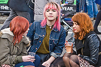 St Patricks Day parade High Street Digbeth.Pink haired girl with two red haired mates High Street's Duel carriageway At their backs Custard Factory.