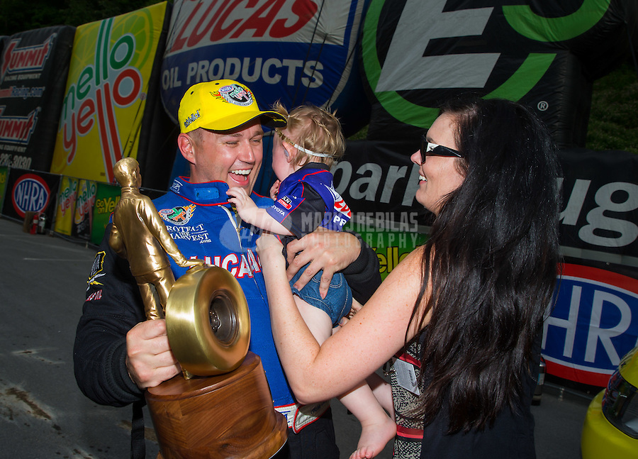Jun 21, 2015; Bristol, TN, USA; NHRA top fuel driver Richie Crampton celebrates with his daughter and fiance after winning the Thunder Valley Nationals at Bristol Dragway. Mandatory Credit: Mark J. Rebilas-