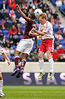 Dax McCarty (11) of the New York Red Bulls goes up for a header with Ross LaBauex (16) of the Colorado Rapids during the first half of a Major League Soccer (MLS) match at Red Bull Arena in Harrison, NJ, on March 25, 2012.