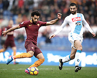 Roma&rsquo;s Mohamed Salah, left, is challenged by Napoli&rsquo;s Raul Albiol during the Italian Serie A football match between Roma and Napoli at Rome's Olympic stadium, 4 March 2017. <br /> UPDATE IMAGES PRESS/Isabella Bonotto