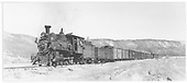3/4 view of RGS #20 hauling freight with helper engine south of Ridgway.<br /> RGS  s. of Ridgway, CO  Taken by Perry, Otto C. - 9/27/1942