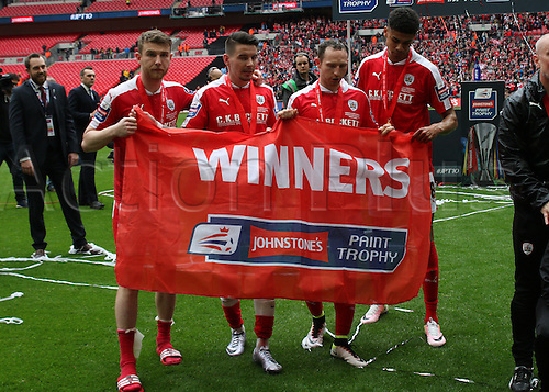 03.04.2016. Wembley Stadium,  London, England. Johnstones Paint Trophy Football Final Barnsley versus  Oxford Utd. Barnsleyplayers celebrate with the a winners flag