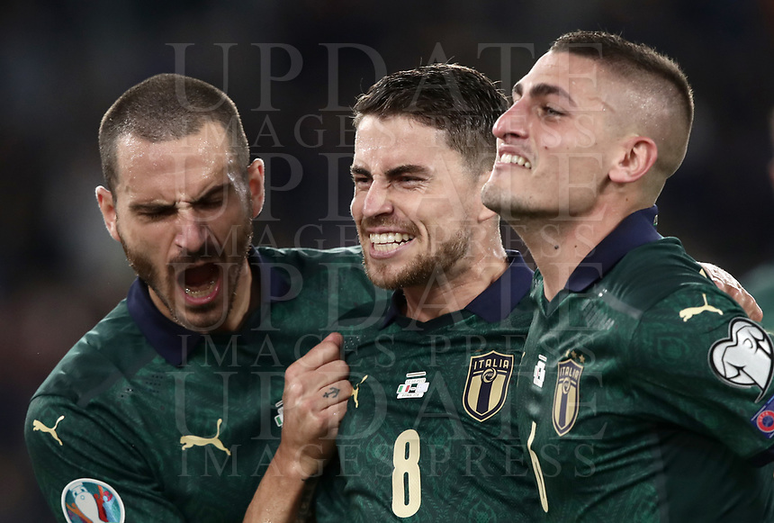 Football: Euro 2020 Group J qualifying football match Italy vs Greece at the Olympic stadium, in Rome, on October 12, 2019.<br /> Italy's Jorginho (c) celebrates after scoring with his team mate Marco Verratti (r) and Leonardo Bonucci (l)  during the Euro 2020 qualifying football match between Italy and Greece at the Olympic stadium, in Rome, on October 12, 2019.<br /> UPDATE IMAGES PRESS/Isabella Bonotto
