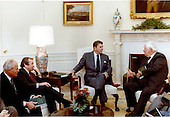 "United States President Ronald Reagan, right center, meets with U.S. House Speaker Thomas P. ""Tip"" O'Neill, Jr. (Democrat of Massachusetts), right, U.S. Senate Majority Leader Howard H. Baker, Jr. (Republican of Tennessee), left center, and U.S. House Minority Leader Robert H. ""Bob"" Michel (Republican of Illinois), left, in the Oval Office of the White House in Washington, D.C. on Monday, January 31,1983 to discuss the President's proposed budget for Fiscal Year 1984..Mandatory Credit: Jack Kightlinger - White House via CNP"