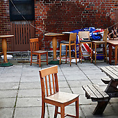 "Reading, Great Britain, April 2010:.Remains of furniture at the backyard of ""The Pheasant"", recently closed community pub..(Photo by Piotr Malecki / Napo Images)..Reading, Wielka Brytania, Kwiecien 2010:.Pozostalosci mebli wlasnie zamknietego pubu ""The Pheasant""..Fot: Piotr Malecki / Napo Images"