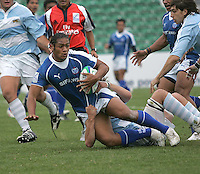 Samoa's Thretton Palamo is well tackled by his Argentinian opponent in the 7th place play off in the Under 19 rwc at Shaw's Bridge Belfast 2007.