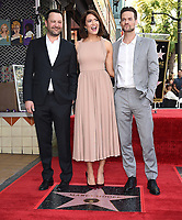 HOLLYWOOD, CA - MARCH 25: Dan Fogelman and Shane West with Mandy Moore at the Mandy Moore star ceremony on the Hollywood Walk of Fame on March 25, 2019 in Hollywood, California. (Photo by Frank Micelotta/20th Century Fox Television/PictureGroup)