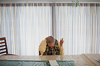Randy Russo, 60, sits at a table after lunch in the residences in Malone Park at the Fernald Developmental Center in Waltham, Massachusetts, USA.  Ronnie and his twin Randy, both blind and unable to speak, have lived at the Fernald Center for 55 years.