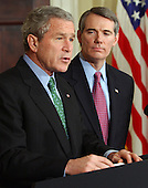 United States President George W. Bush names United States Representative Rob Portman (Republican of the 2nd District of Ohio) as his nominee for United States Trade Representative in the Roosevelt Room of the White House in Washington, D.C. on March 17, 2005.   <br /> Credit: Roger Wollenberg - Pool via CNP