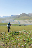 Georgia Bennett takes in the scenery from Caribou Pass, along the Kongakut River, in Alaska's Arctic National Wildlife Refuge.