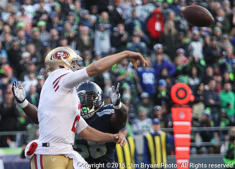 San Francisco 49ers quarterback Blaine Gabbert (2) passes under pressure from Seattle Seahawks linebacker Kevin Pierre-Louis (58)  at CenturyLink Field in Seattle, Washington on November 22, 2015.  The Seahawks beat the 49ers 29-13.   ©2015. Jim Bryant Photo. All RIghts Reserved.