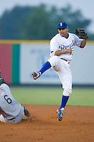Shortstop Jorge Gutierrez (13) of the Burlington Royals follows through on his throw to first base to complete a double play at Burlington Athletic Park in Burlington, NC, Wednesday, August 13, 2008. (Photo by Brian Westerholt / Four Seam Images)
