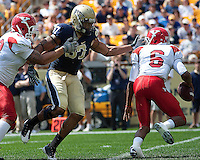 Pittsburgh defensive lineman Jaabaal Sheard putting pressure on Youngstown State quarterback Brandon Summers. The Pittsburgh Panthers defeated the Youngstown State Penguins 38-3 at Heinz Field on September 5, 2009.